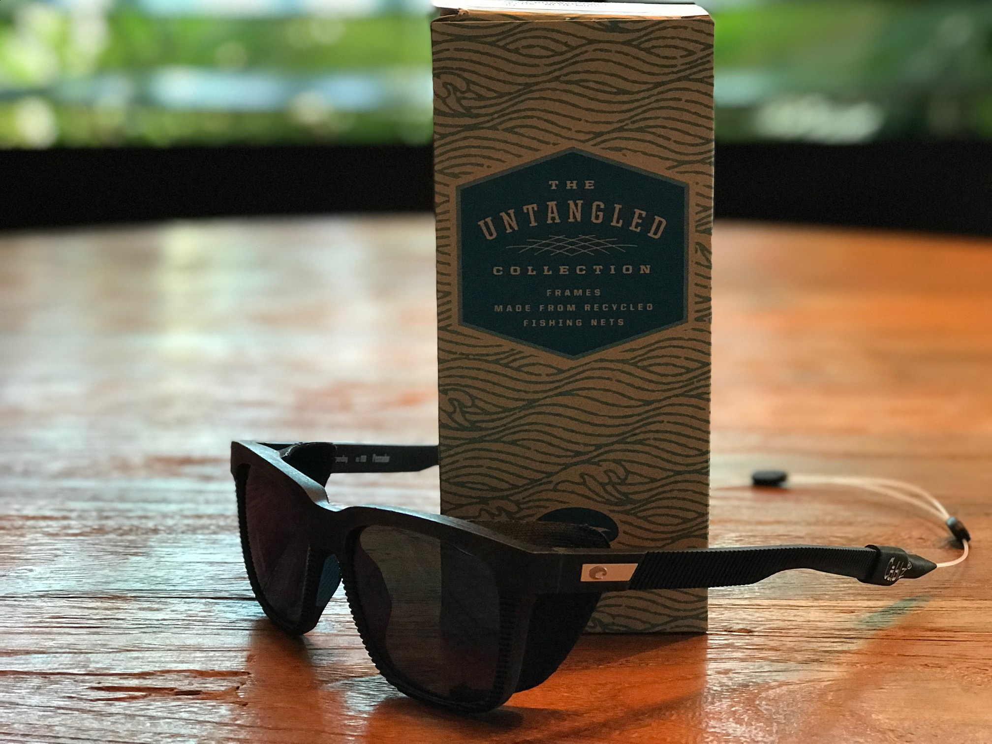 "Costa Pescador sunglasses with side skirt and box, part of the ""Untangled"" eco-friendly series"